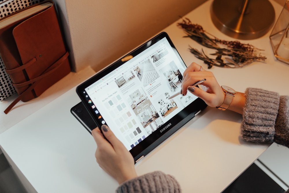 Women using stylus on tablet