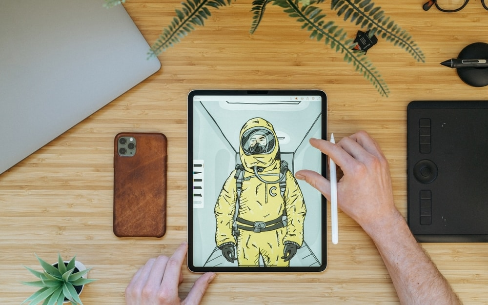 Astronaut on a drawing tablet