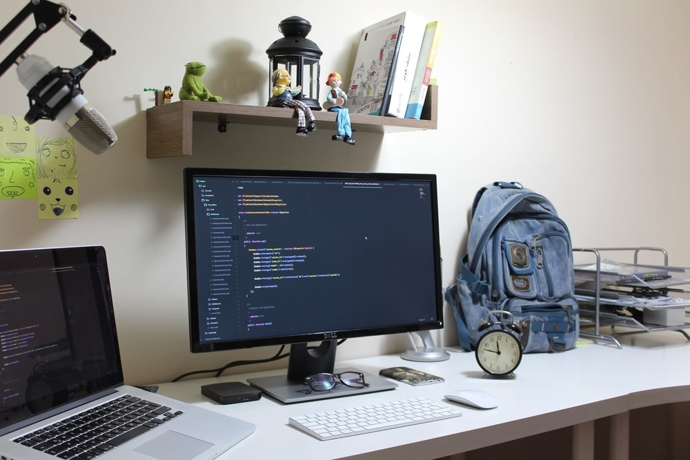 Monitor with bag and laptop
