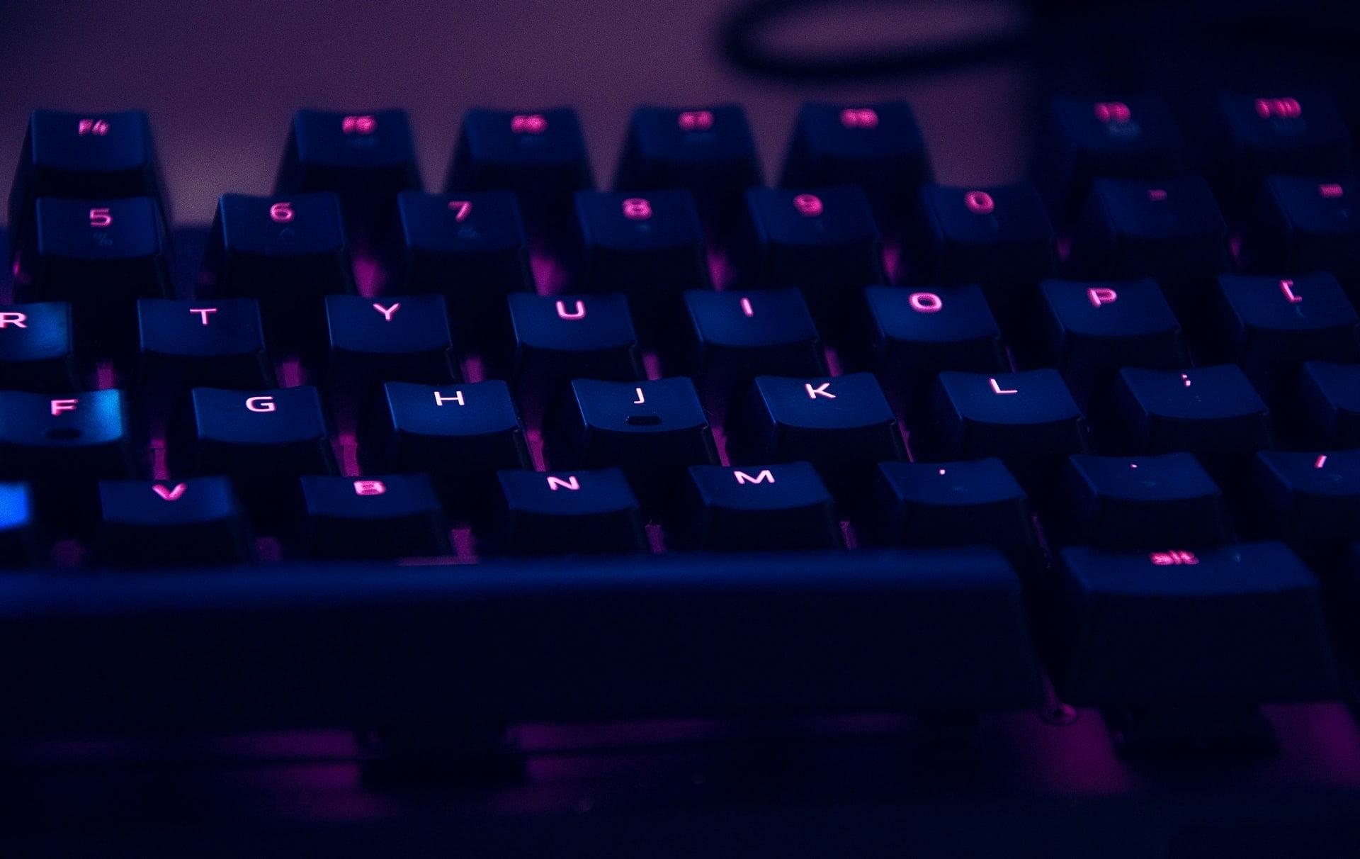 closeup of rgb pink keyboard with black keys