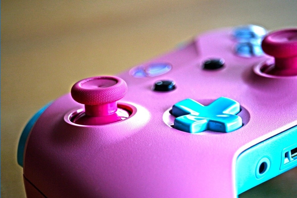 Pink Xbox controller with pink toggles